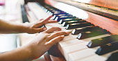 Child Girl Playing Piano, Close Up View