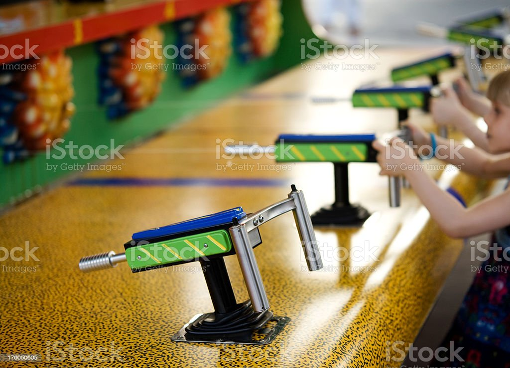 Child Girl Playing Water Game at Carnival Summer Lifestyle stock photo