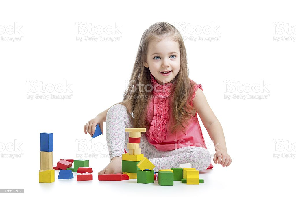 child girl playing with block toys over white background royalty-free stock photo