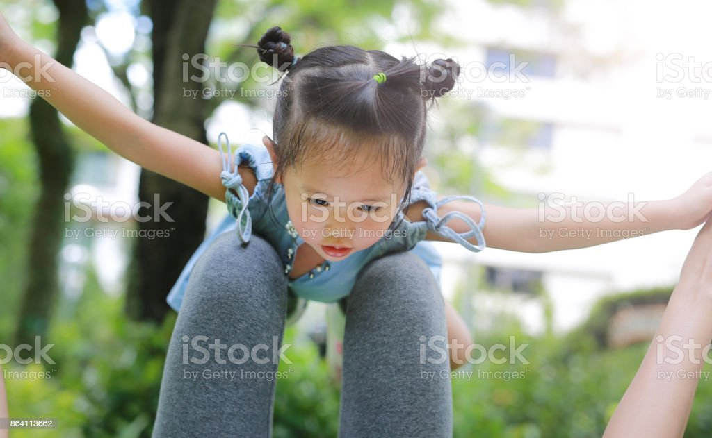 Child girl playing with mother and floating in the air. royalty-free stock photo