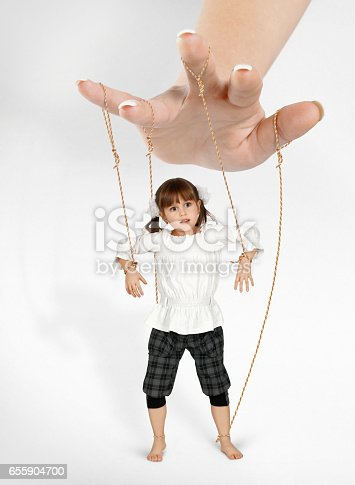 istock child girl - puppet , dependence concept 655904700