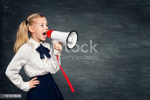 991060890 istock photo Child Girl Scream Advertisement to Megaphone, Kid In School Dress Advertising on Blackboard 1167618539