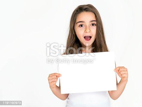 Child girl smiling hold white sheet blank isolated