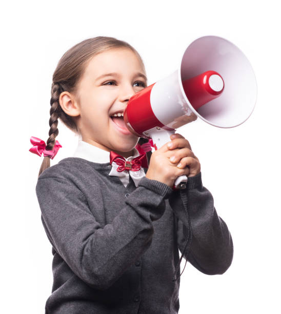 Child Girl Student Shouting Through Megaphone Isolated on White Background. Back to School Concept. stock photo