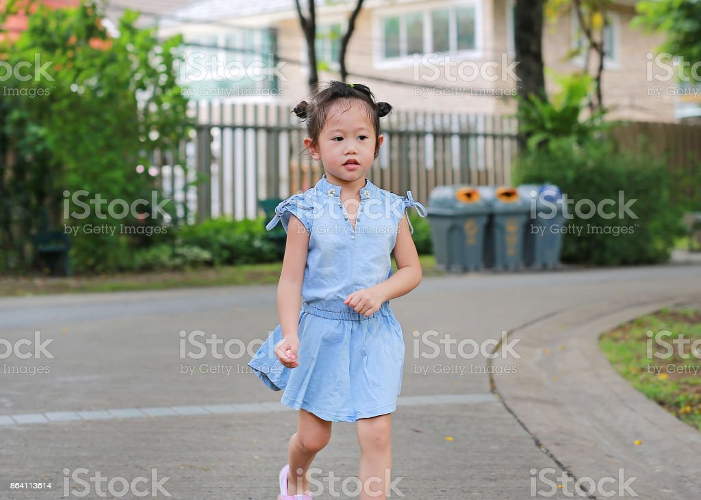 Child girl walking in the park. royalty-free stock photo