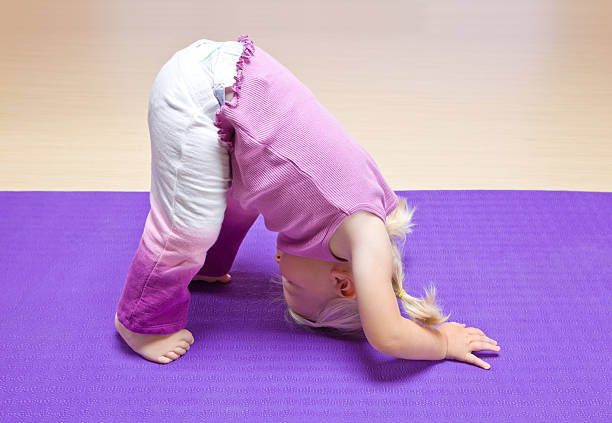Child Girl Yoga Pose stock photo