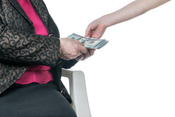child gives money to a grandmother - kindergeldantrag stock-fotos und bilder