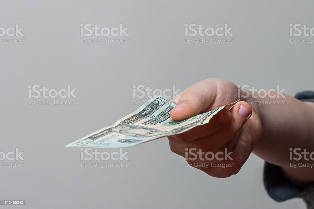 Child Giving Money stock photo