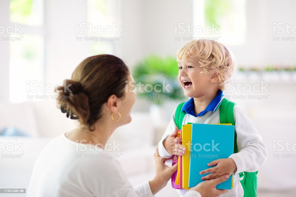 Child going back to school. Mother and kid getting ready for first...