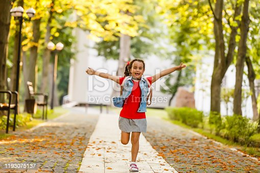 834369132 istock photo Child going back to school. Start of new school year after summer vacation. Little girl with backpack and books on first school day. Beginning of class. Education for kindergarten and preschool kids. 1193075137