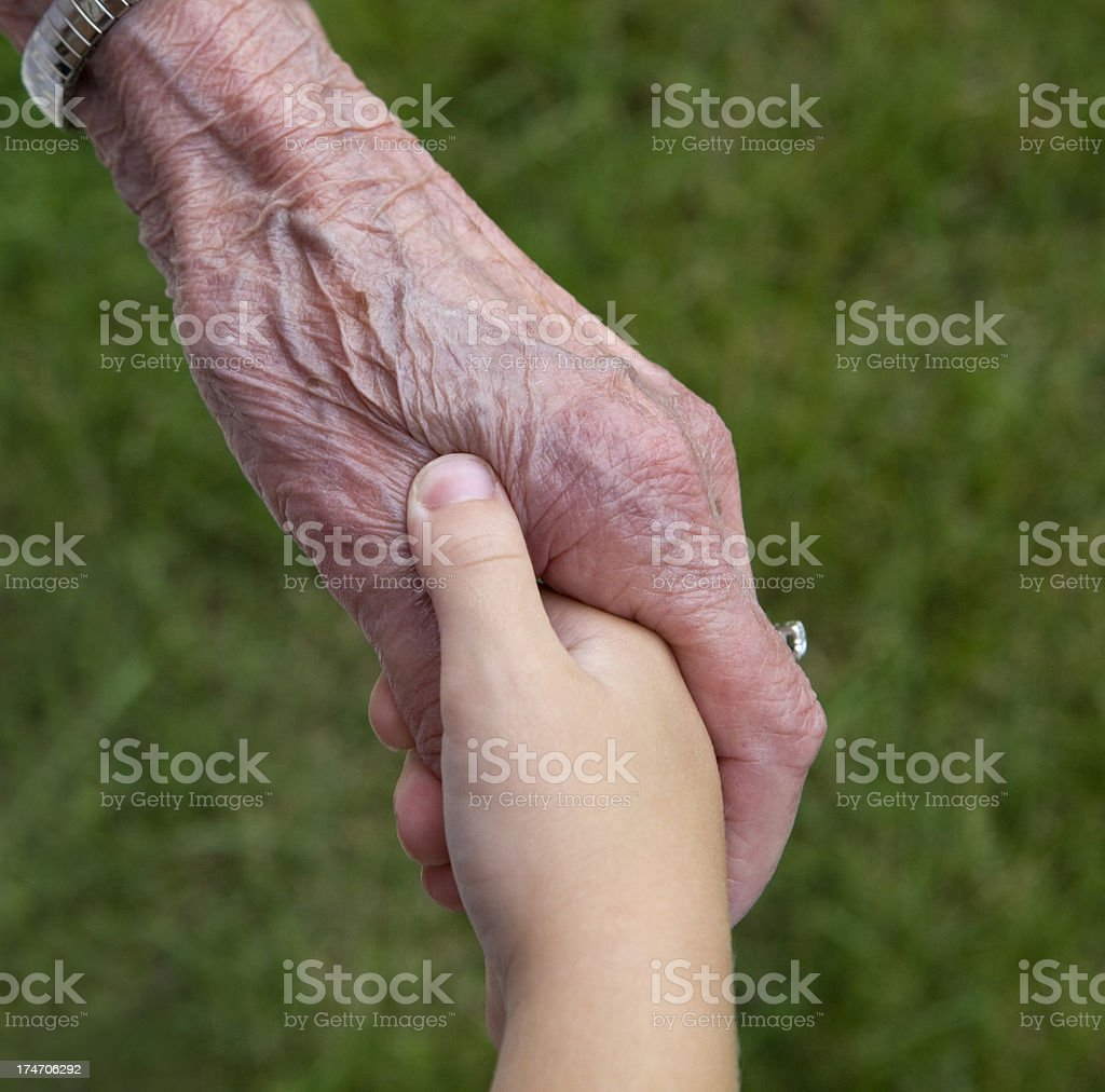 Child Grasping Great Grandmother's Thumb royalty-free stock photo