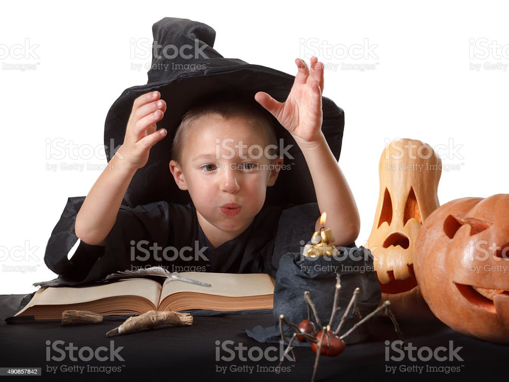 Child, Halloween pumpkin with magical things stock photo