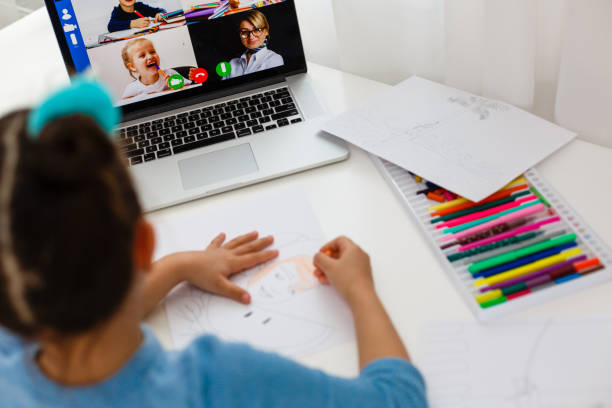 Child hand draws a color pencil. Distance Learning stock photo