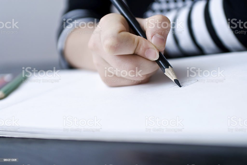Child hand draws a pencil royalty-free stock photo
