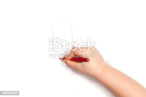 istock Child hand draws the heart 898289692