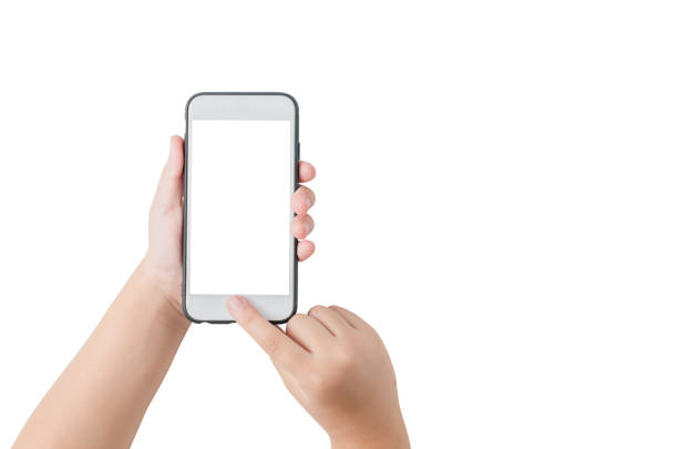 child hand hold mobile phone and touch on screen stock photo