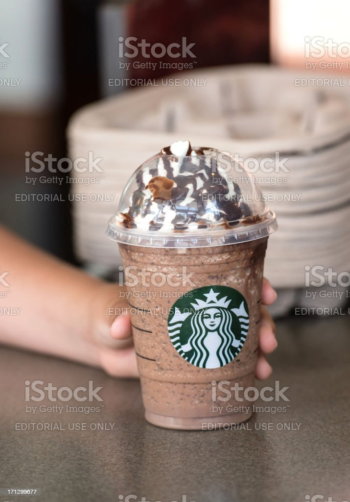 Child hand holding a coffee Frappuccino royalty-free stock photo