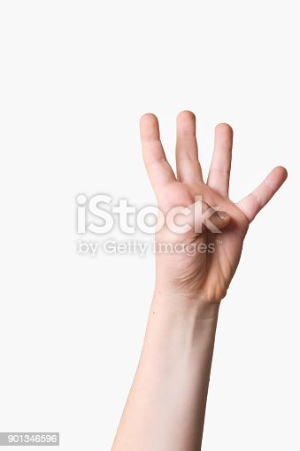 istock Child hand holding up five fingers on a white background 901346596