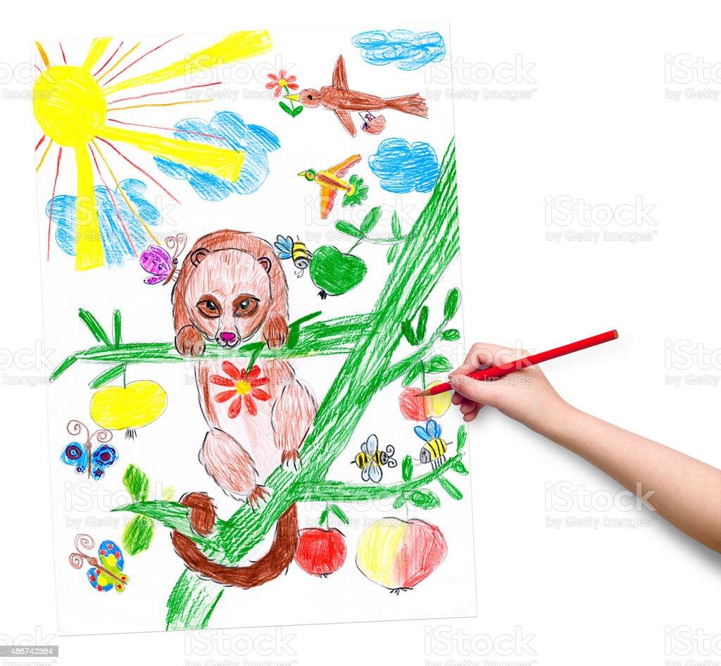 Enfant la main avec un crayon dessine une image - Photo