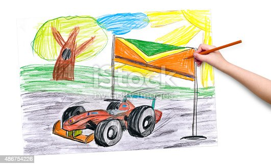 istock child hand with pencil draw a picture 486754226