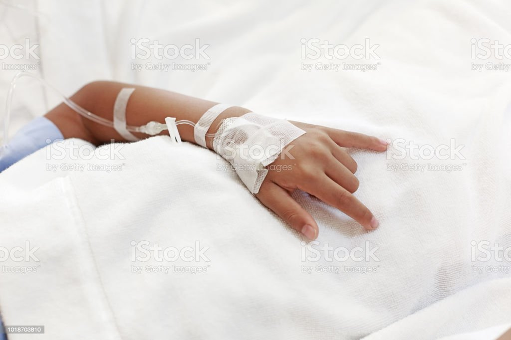 A child hand with Sodium Chloride Solution for Intravenous stock photo