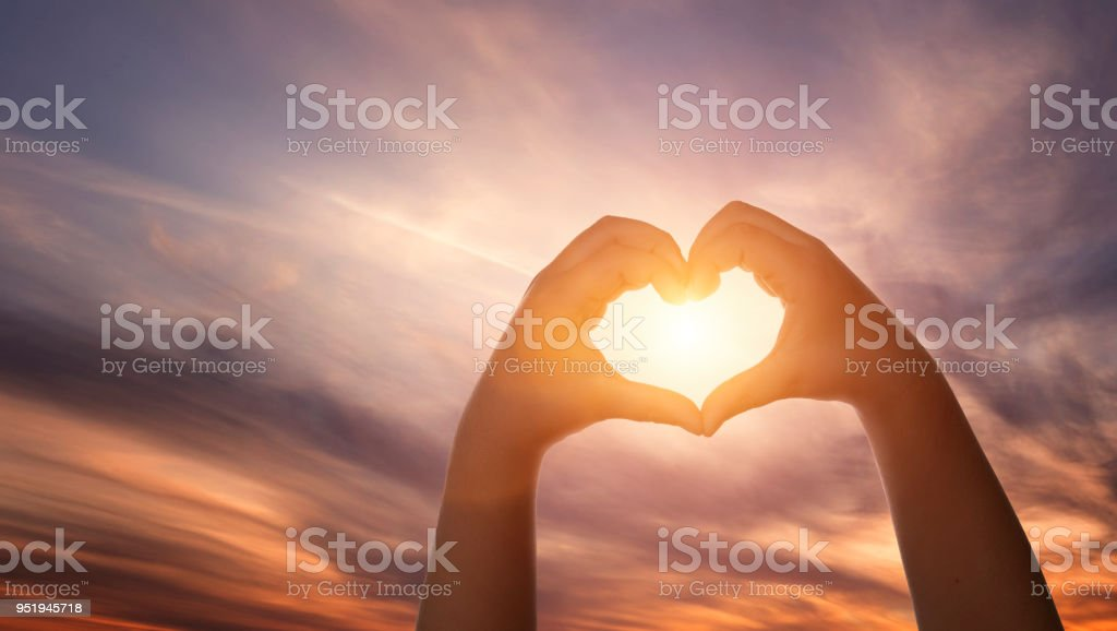 Child hands formig heart shape Close up of child hands formig heart shape over beautiful sky with copy space Beach Stock Photo