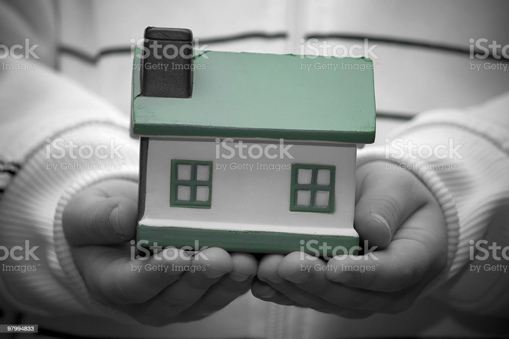 Child hands holding house royalty-free stock photo