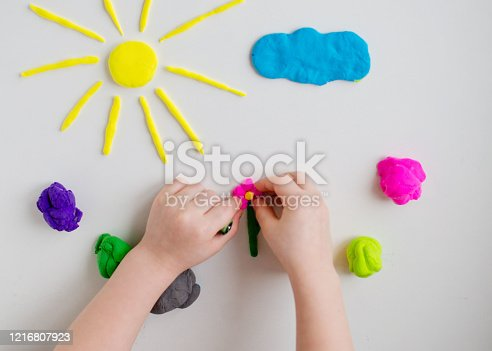 926151996 istock photo Child hands playing with colorful clay. Homemade plastiline 1216807923