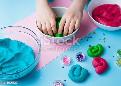 926151996 istock photo Child hands playing with colorful clay. Homemade plastiline. Plasticine. play dough. Girl molding modeling clay. Homemade clay. 1216806122