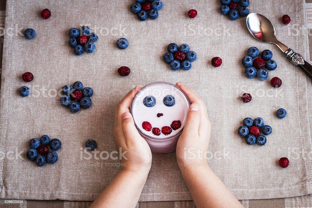 Child hands with yoghurt stock photo