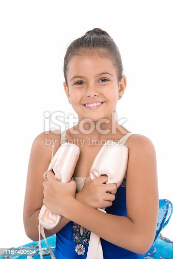istock Child happy holds ballet shoes important attribute excellent ballerina. Girl ballerina holds pointe shoes in hand white background. Professional advice. Exercises to develop pointe shoes dance skill 1187400554