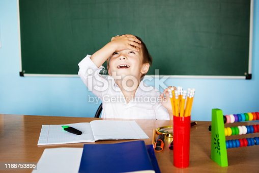 istock Child having a Eureka moment and Eureka concept for genius student, university education and future aspirations. Back to school concept 1168753895