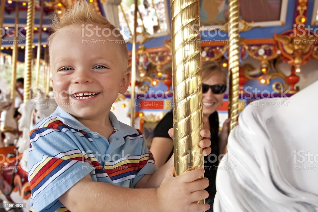 Child Having Fun on the Carousel stock photo