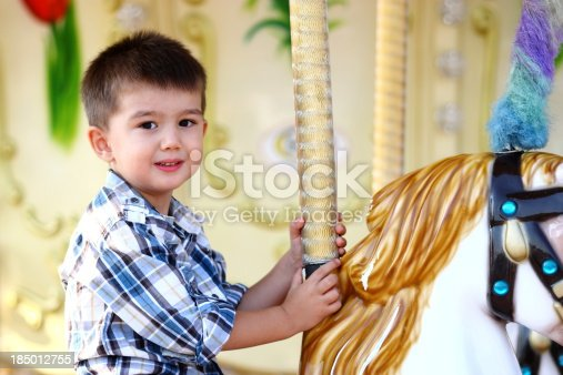 Child Having Fun on the Carousel.