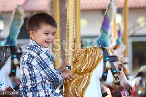 Child Having Fun on the Carousel