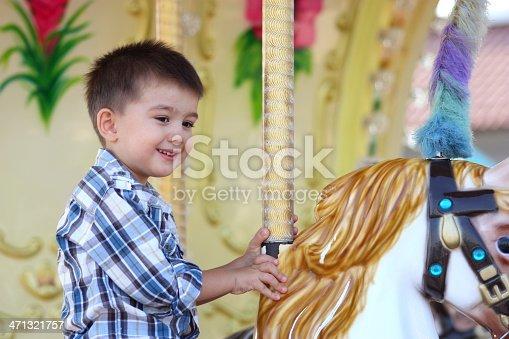 Child Having Fun on the Carousel.
