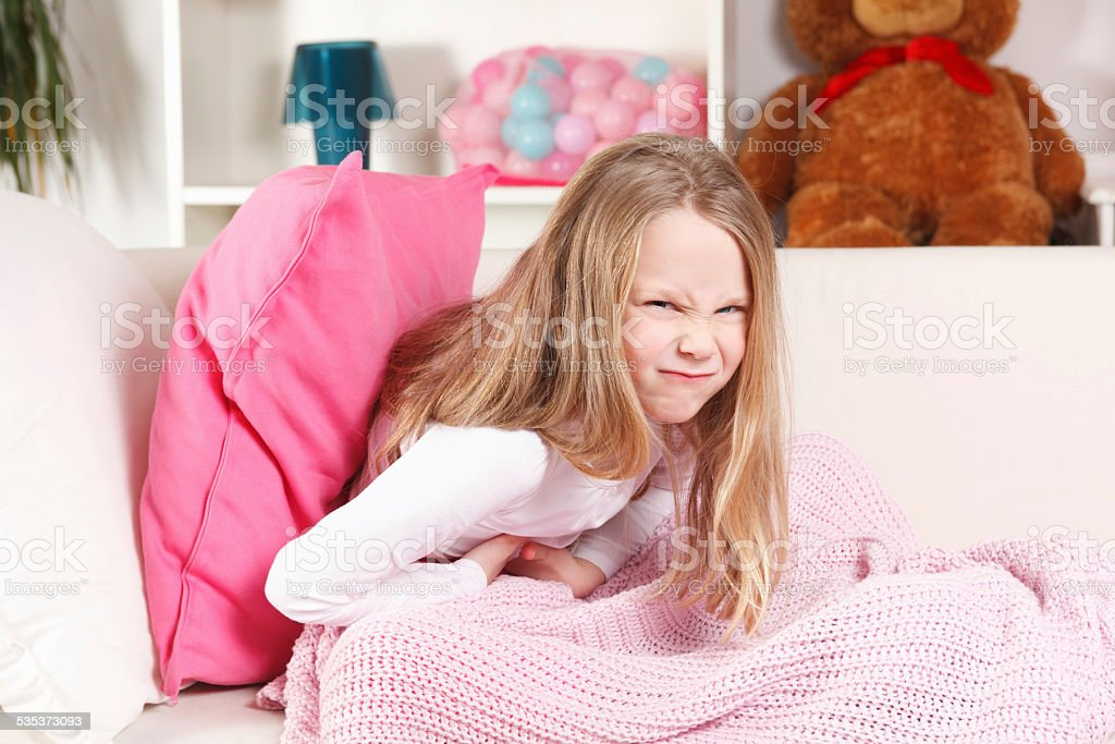 Child having stomach ache stock photo