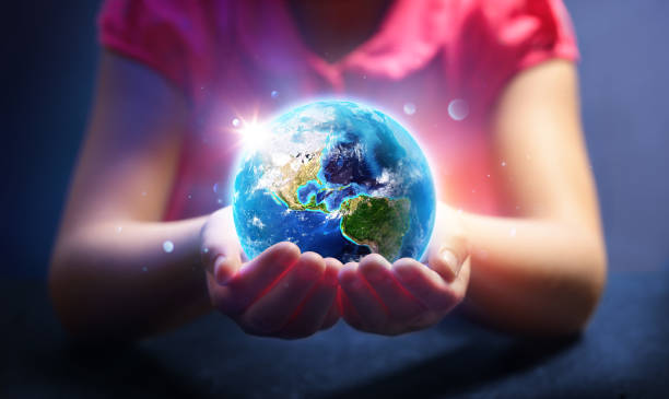 child hold world - earth day concept - earth day stock pictures, royalty-free photos & images