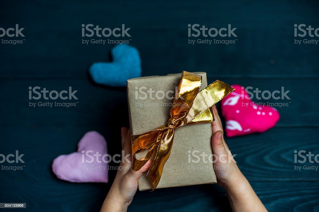 Child holding a gift box with golden