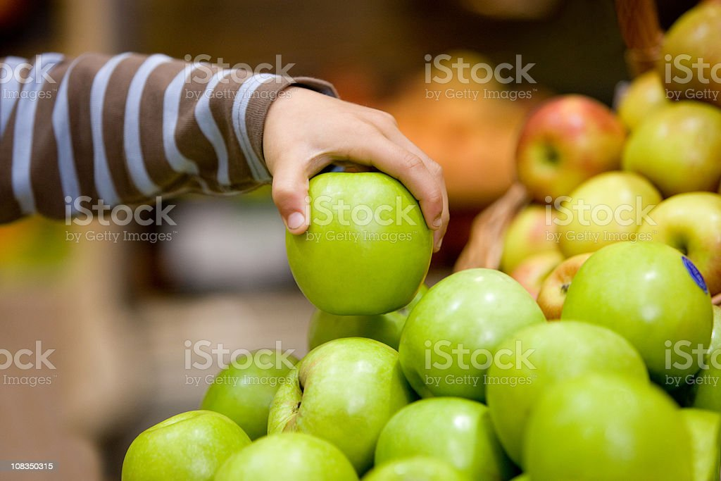 Child holding an apple stock photo