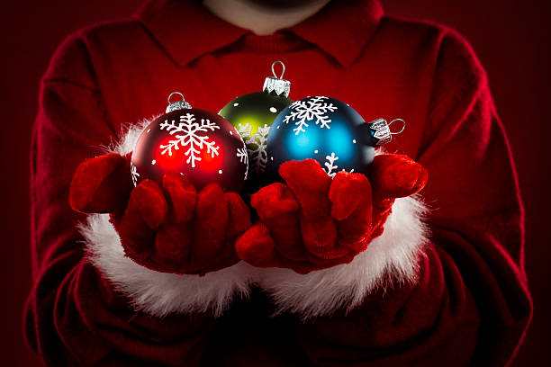 Child holding baubles stock photo
