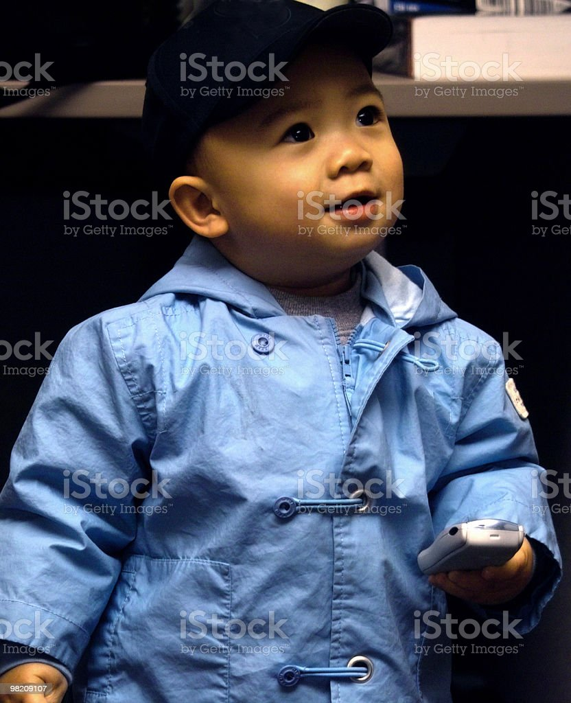 Child Holding Cell Phone royalty-free stock photo