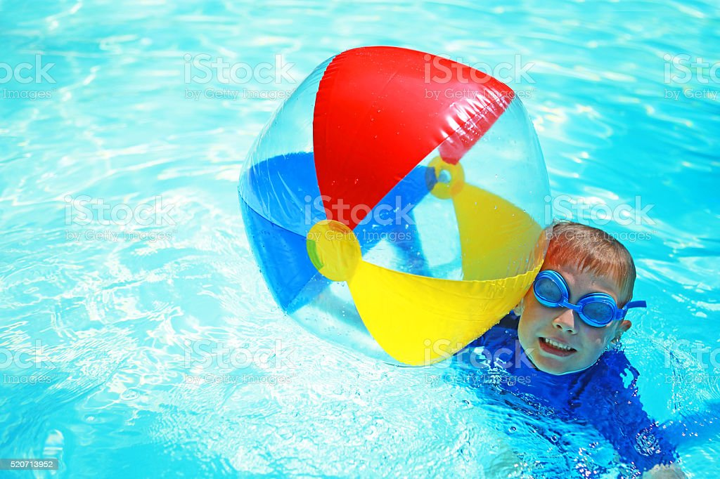 beach ball in pool. Child Holding Colorful Beach Ball In Swimming Pool Stock Photo