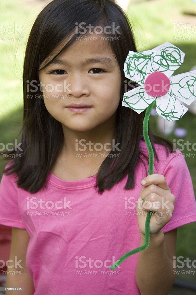 Child holding homemade flower royalty-free stock photo