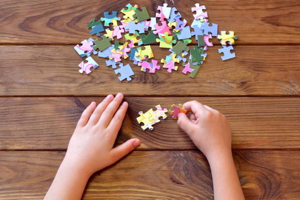 Child holding multicolor puzzles in hands education concept top view picture id1215683383?b=1&k=6&m=1215683383&s=612x612&w=0&h=2ldwb liz8mme1g2gc aqfdmo0wvj3zuf3mfya cbei=