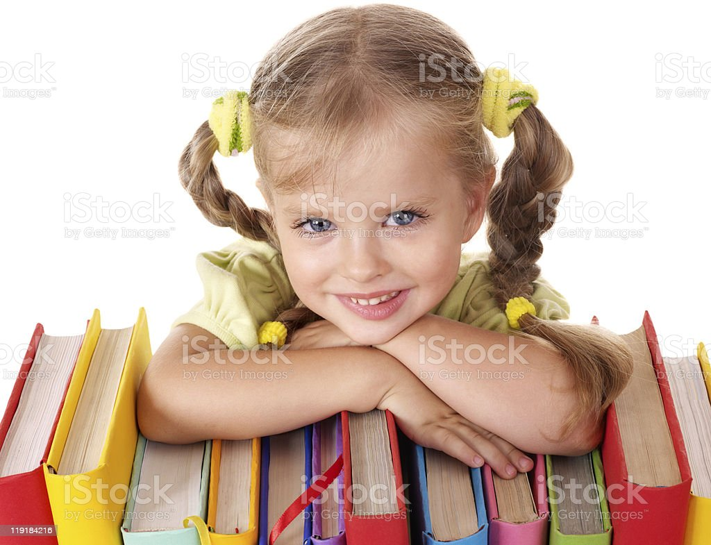 Child holding pile of books. stock photo