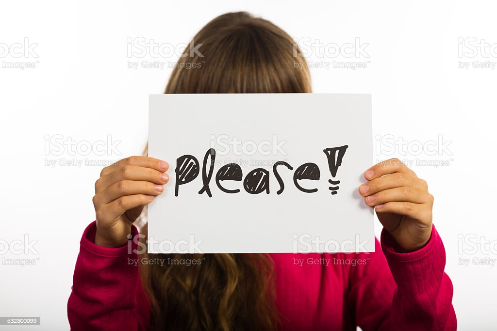 Child holding Please sign stock photo