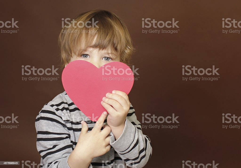 Child holding Valentine's Day Heart Sign stock photo