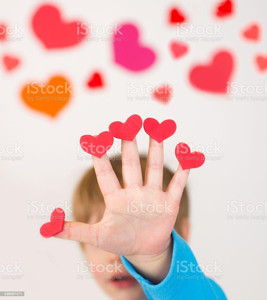 Child Holding Valentine's Day Hearts stock photo