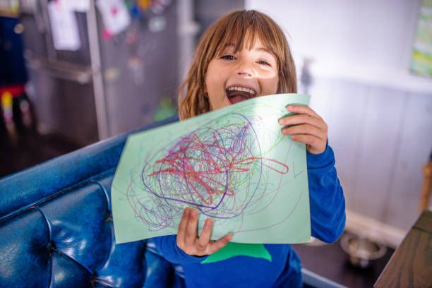 Child holds up drawing she made stock photo